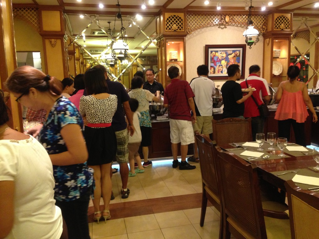 Cebu tourists and locals line up for Pino's buffet.