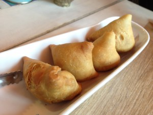 Vegetarian Samosa. It's like empanada stuffed with Indian spiced vegetables.