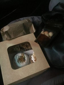 My Crostatina Patisserie and Cafe loot, occupying the passenger seat.