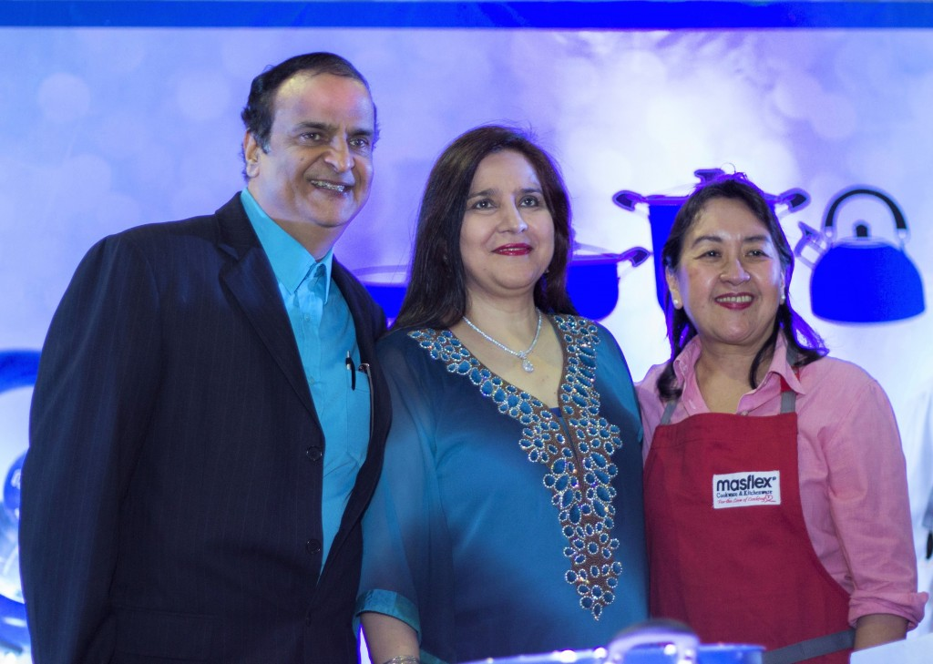 Nancy Reyes-Lumen with Masflex owner Haresh Mirchandani and his wife, Nareena