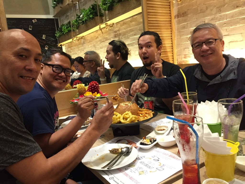 Spotted enjoying the Chicken Cheese fondue during the grand opening: Jeman Villanueva of orangemagazine.ph, John Michael Bueno of kumagcow.com, and Ricky Bautista and Mario Dumaual of ABS-CBN